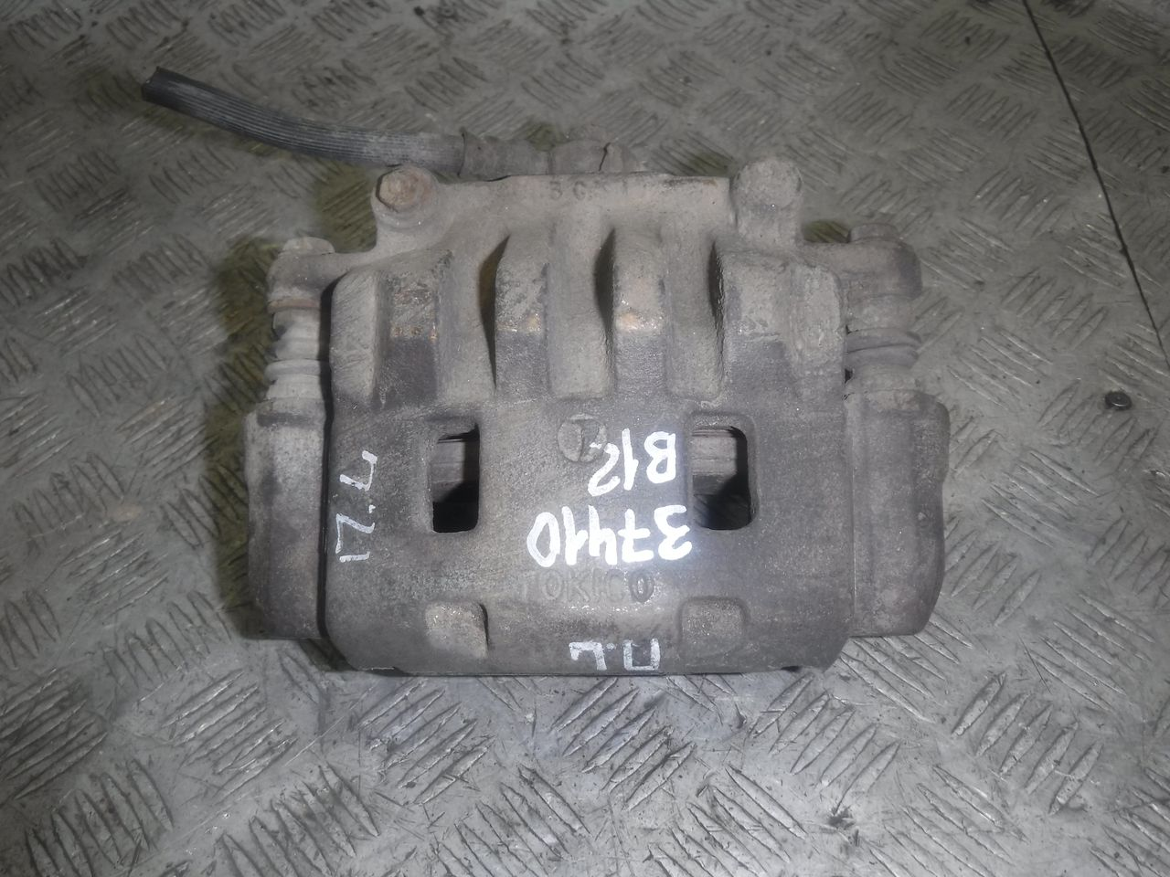 Суппорт тормозной передний